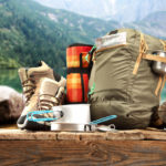 Camping equipment including bag, pots, pans and hiking shoes